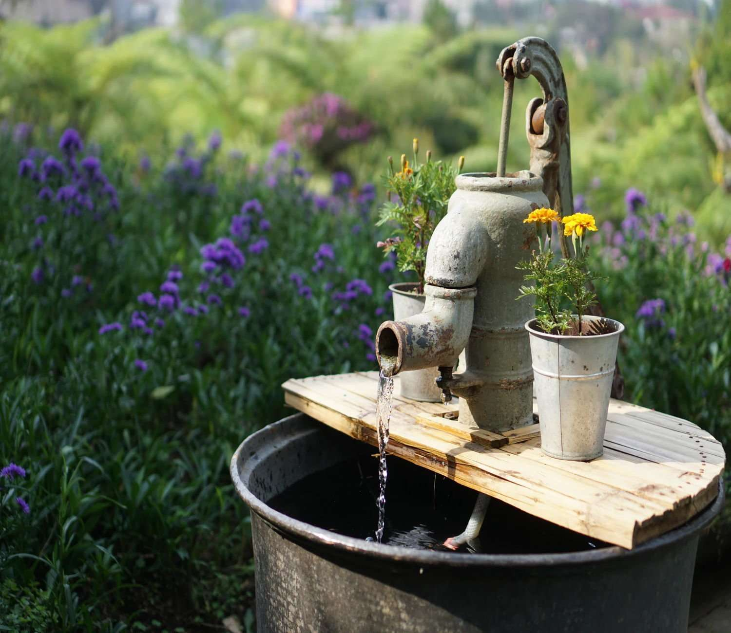 Using an alternative container like a bucket can bring charm to your artificial plants and flowers
