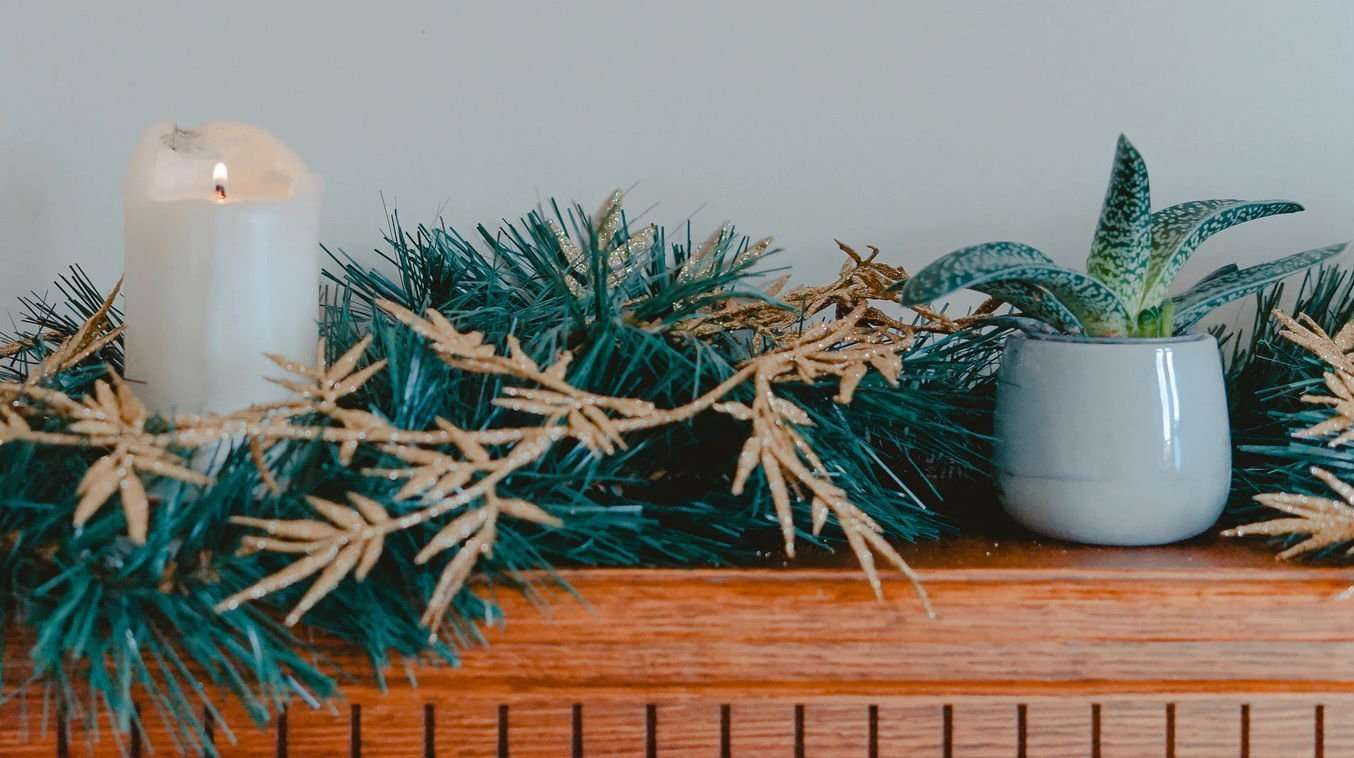 Your fireplace mantel is a great place for a small artificial plant or flower arrangement